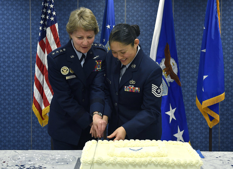 Lt Gen Maryanne Miller and Tech. Sgt. Rubelle Pineda cut the Air Force Reserve's birthday cake